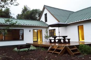 Gypsy Forest - R1200/night for house (sleeps 7): A large deck for entertainment and lounging during the day or viewing stars at night. Braai for outside cooking.